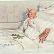 Xmas Postcard: Little Girl praying. Doll lying beside her. 1922
