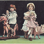 Sweet vintage postcard of Children with Dolls.