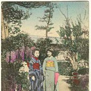 2 Japanese Ladies in Kimonos in a Garden. Vintage postcard.