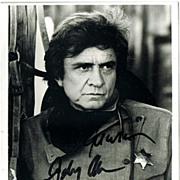 Johnny Cash Autograph: Hand signed Photo. CoA