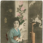Japanese Lady in Kimono, doing Ikebana. Vintage postcard.