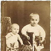 Two Kids with Teddy Bear. Old Studio Photo