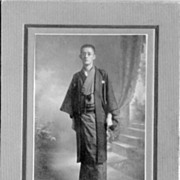 Old Japan: Cabinet photo depicting a young man in a Kimono
