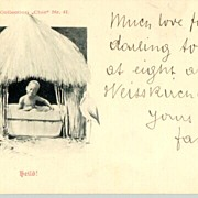 "1899: ""Heilo"", b/w postcard depicting a little black Boy in his hut"