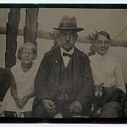 Older Gentleman with 2 Children an a Dog Photograph