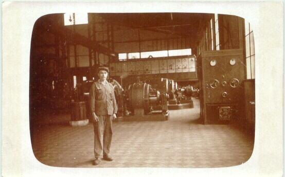 Vintage Photo showing a Worker in a Factory, Machinery behind