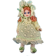 "2 1/2"" Bisque Dollhouse Girl Doll with Googly Eyes by Doris Bradley Green Ensemble"