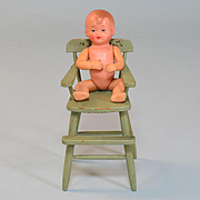 "Painted Wood Dollhouse High Chair with Celluloid Baby 1920 – 1930s Large 1"" Scale"