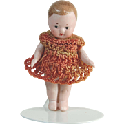 Antique all bisque doll pink crocheted dress miniature dollhouse doll Germany   2 1/4""