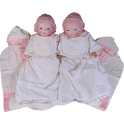 Pair Bye-Lo babies Sisters Twins matching gowns pink and white bonnets booties bibs and buntings