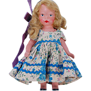 Nancy Ann Storybook all bisque doll blonde blue white print dress blue rick rack trim