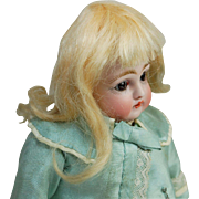 Doll wig antique blonde mohair small size with attached pate and short bangs 5 inch head circ.