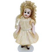 Antique Mignonette all bisque doll CM doll solid dome head glass eyes peg strung original blonde wig dress unders lace bonnet 4.25 inch