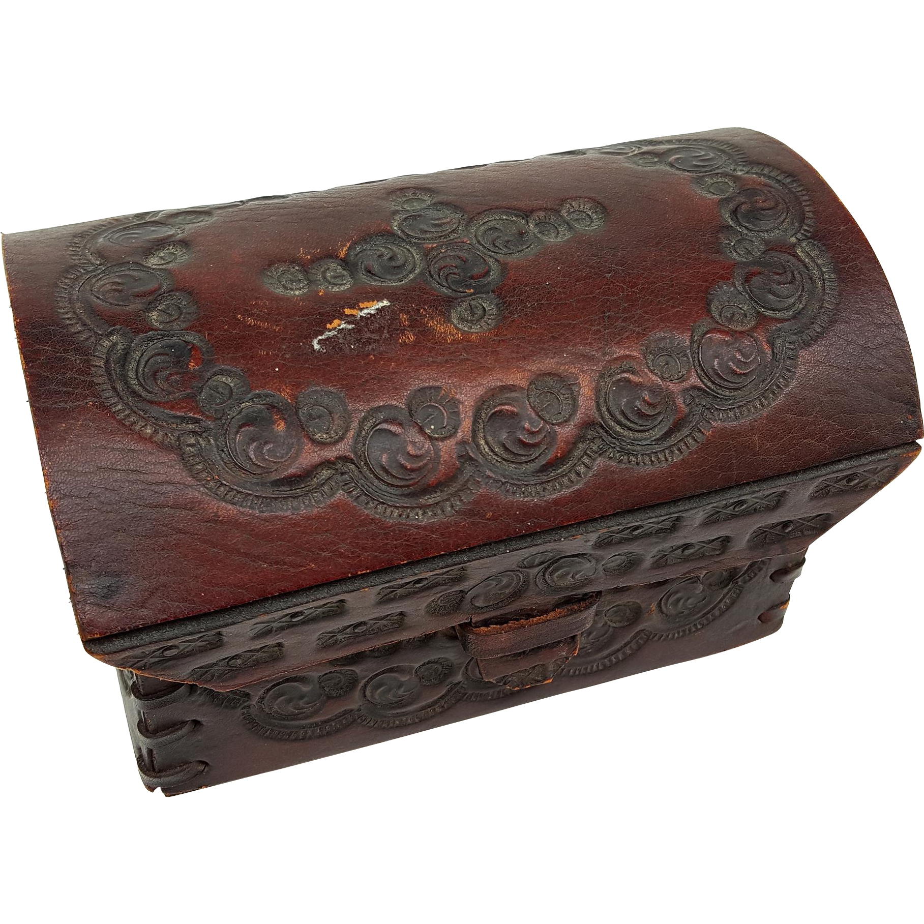 Antique miniature ornately hand tooled thick leather domed top trunk box chest doll size laced leather sides tongue loop closure 6.5 inch wide