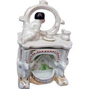 Antique porcelain fairing trinket dresser box baby infant child on dresser bureau looking in mirror  3.75 inch