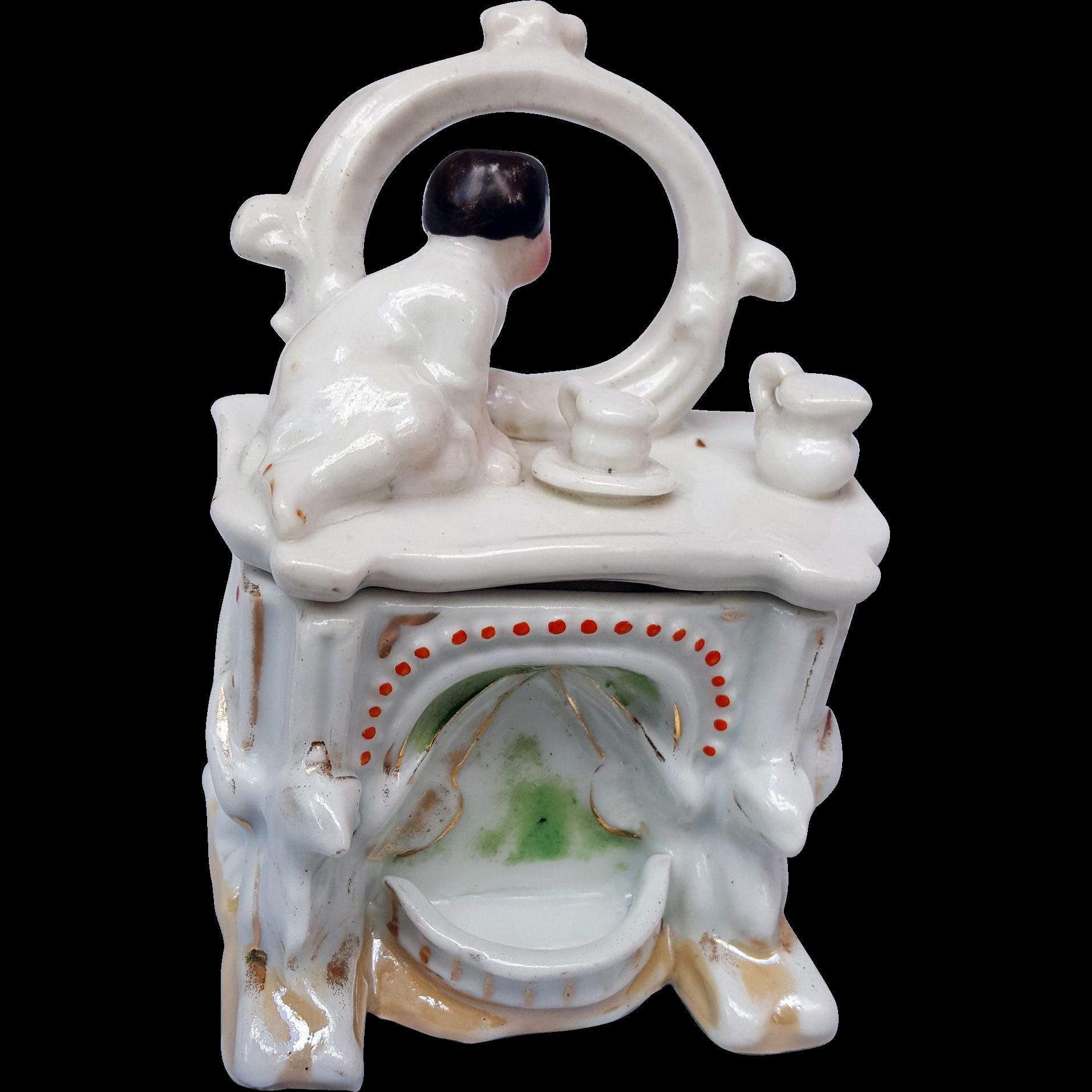 Antique porcelain fairing trinket dresser box baby infant child on dresser bureau looking in mirror  3.75 inch