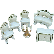 Group glazed white porcelain doll parlor furniture chairs love seat chest sideboard candelabra Japan gilt trim