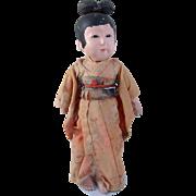 Petite Japanese gofun child doll swivel head nonworking squeaker painted black hair very worn original kimono signed 9.75 inch