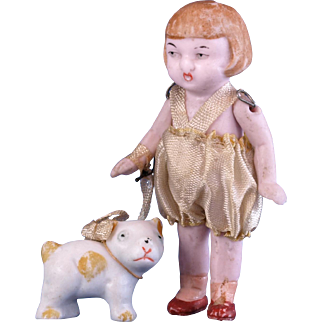 Germany all bisque doll and her pet yellow spotted dog all bisque dog on ribbon leash Germany 3564 blonde page boy bobbed hair girl original romper and ribbon leash