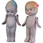 Pair of all bisque dolls little boy in blue stocking cap and slippers and blonde flapper girl jointed at the shoulders made in Japan 2.75 inch