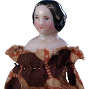 Tiny 2.5 inch covered wagon china glazed porcelain head doll with tiny stump arms and hand sewn fabric body and hand sewn  simple clothes