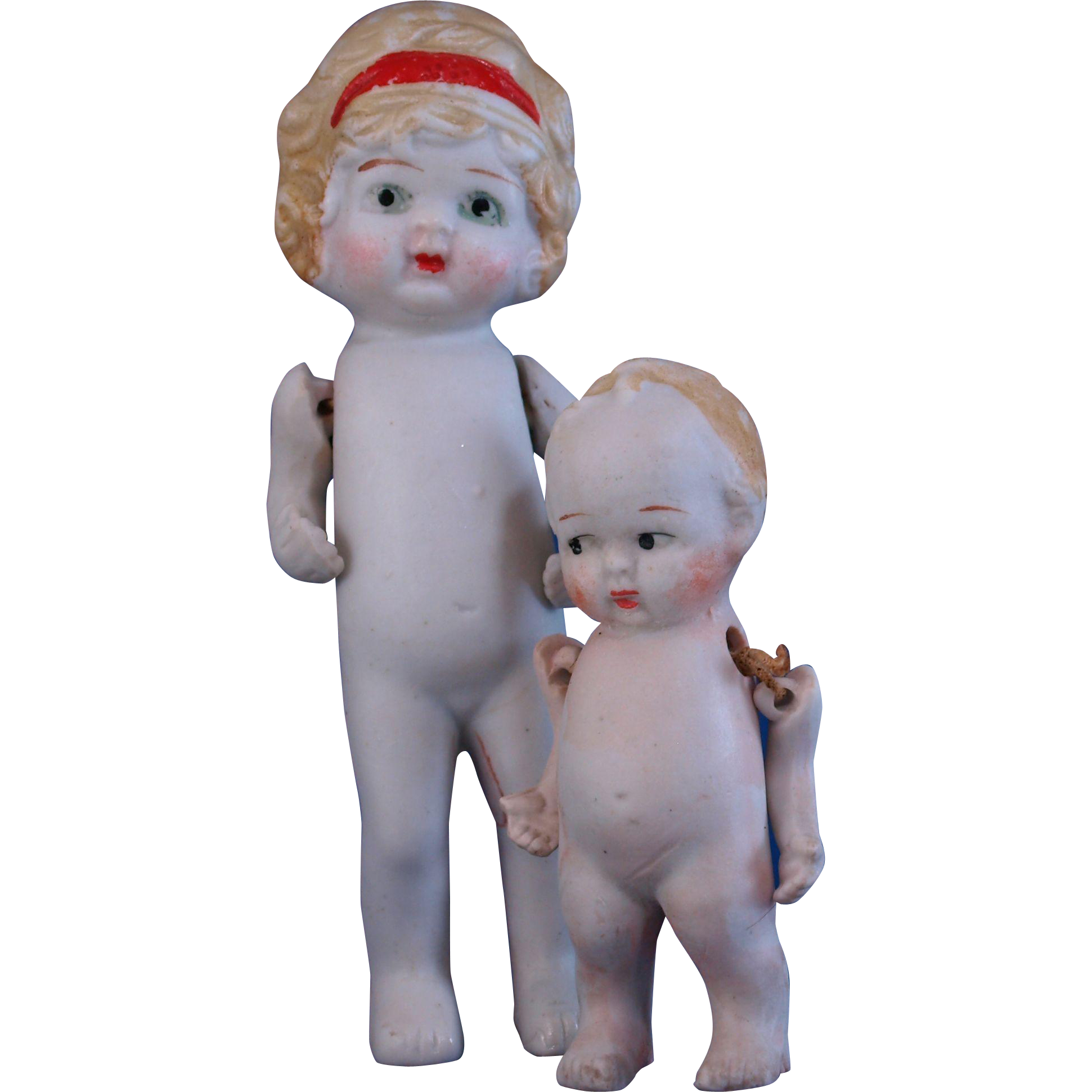 Pair of all bisque dolls big sister flapper red hairband and little brother made in Japan 6 and 4 inches tal