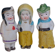 Three all bisque immobiles dolls costumed as cowboy and Indians Made in Japan   2.25 inches tall