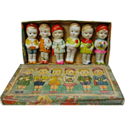 All bisque immobile dolls boys and girls in original worn box Made in Japan six dolls  2 3/4 inches