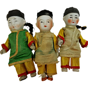 Three jointed all bisque Asian dolls in original costume Made in Japan Bisque Dolls 3 3/4 inches tall stiff necks