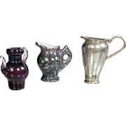 Three tiny dollhouse miniatures grey white porcelain pitcher France ruby blown glass pitcher silvertone metal pitcher 1 inch or less