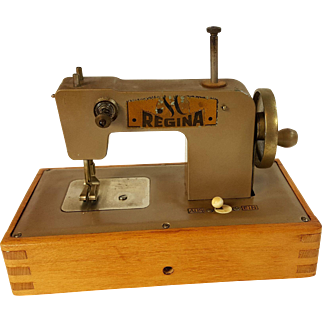 Vintage REGINA child's sewing machine wood and metal hand and 1.5 volt battery operated toy sewing Germany US Zone Berlin 1945-1952