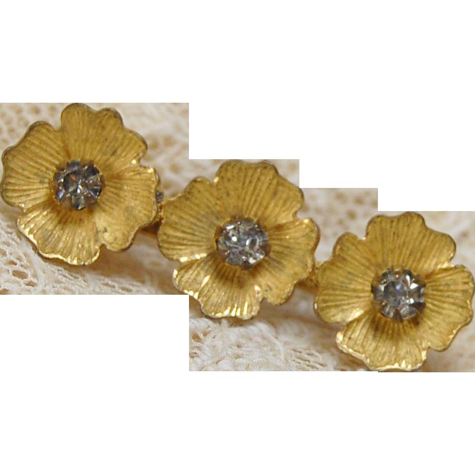 Vintage gold finish doll size rhinestone pin three flower petals glass rhinestone center tiny 1 1/8  with a C clasp