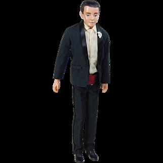 Vintage Ken black flocked hair first issue Mattel doll wearing number 787 Tuxedo black suit cummerbund shoes