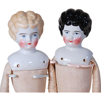 Pair of German 13.5 inch China head dolls blonde and black common hairstyle sister dolls glazed porcelain blue ribbon brown boots original NOS