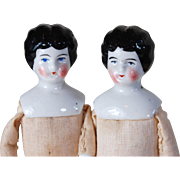 Pair German china head dolls 8 inch twins glazed porcelain black common hair style original blue boots NOS dolls ready to dress