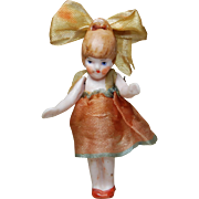 All bisque flapper doll with hair loop huge ribbon bow matching dress wire jointed shoulders 2 3/8 inches