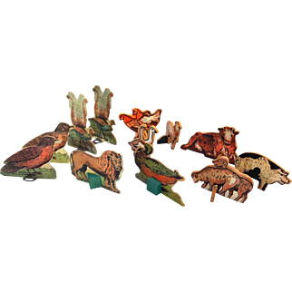 Vintage litho cardboard cutout animals and birds 12 double sided figures with metal wood stands peacocks  chickens lamb lion pig duck sheep