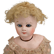 Antique Papier Mache doll 13 inch glass eyes swivel head shoulderplate skin wig leather body tattered original pink net lace dress