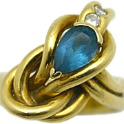 18karat Yellow Gold Blue Topaz and Diamond Knot Motif Ring