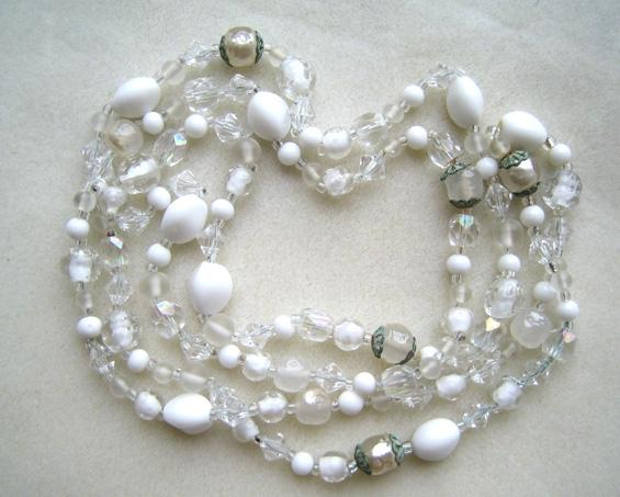 Unsigned White Glass Beads with Filigree Caps