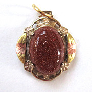 Goldstone Floral Pendant