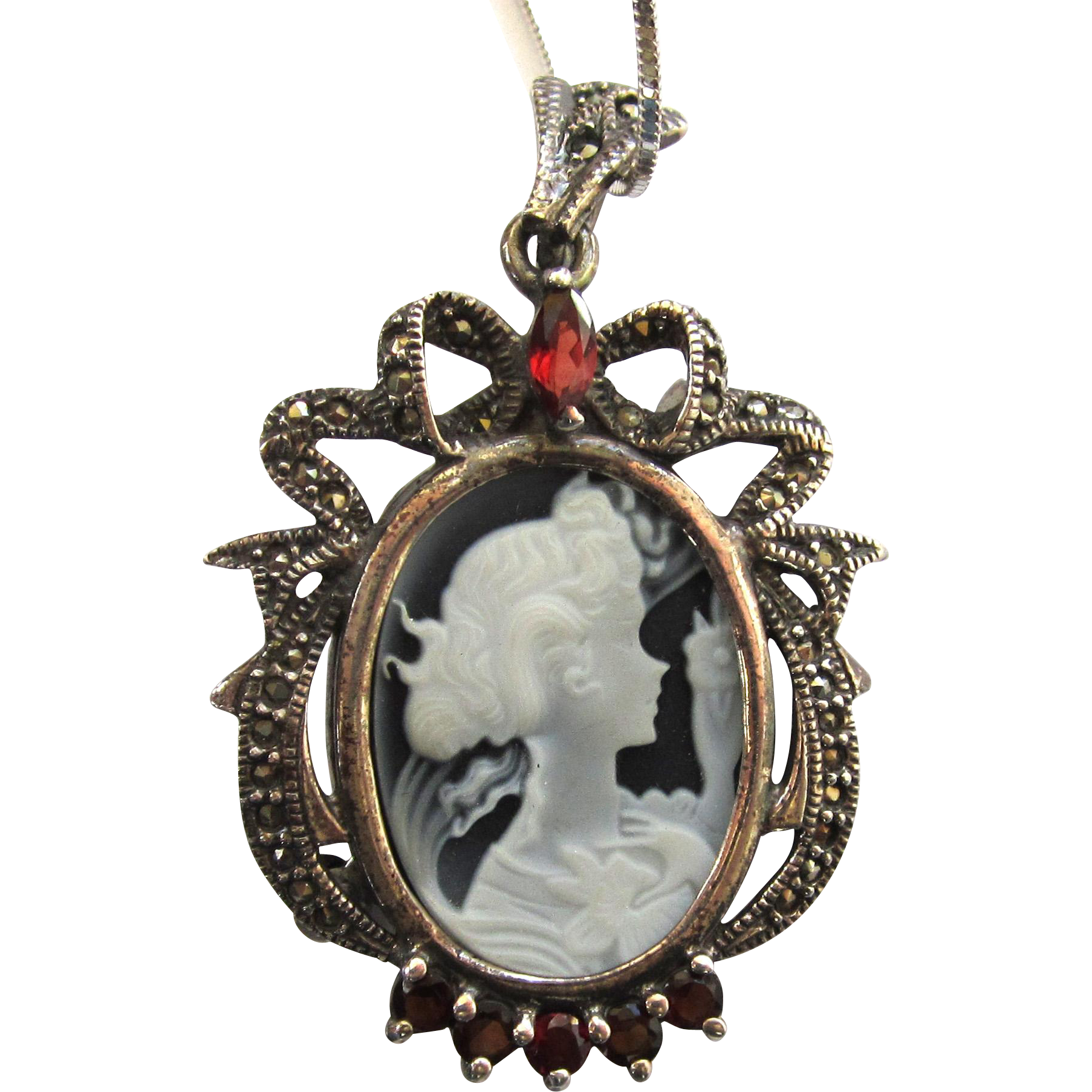 Sterling Silver Black and White Cameo Pendant with Garnets and Marcasites