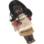 Small hard plastic frozen charlotte doll Hawaiian