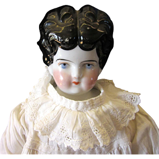 Old much loved 18 inch china head doll