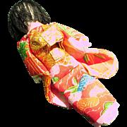 Oriental tiny doll house size doll