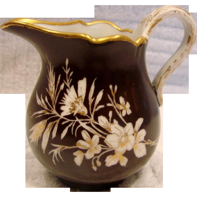 German Meissen Tiny Cream Pitcher Black Ground White Gold Flowers c 1814 - 1860