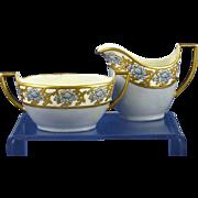 """Zeh, Scherzer & Co. Bavaria Arts & Crafts Blue & Gold Floral Motif Creamer & Sugar Set (Signed """"E. Lundstrom Rowland""""/c.1880-1925)"""