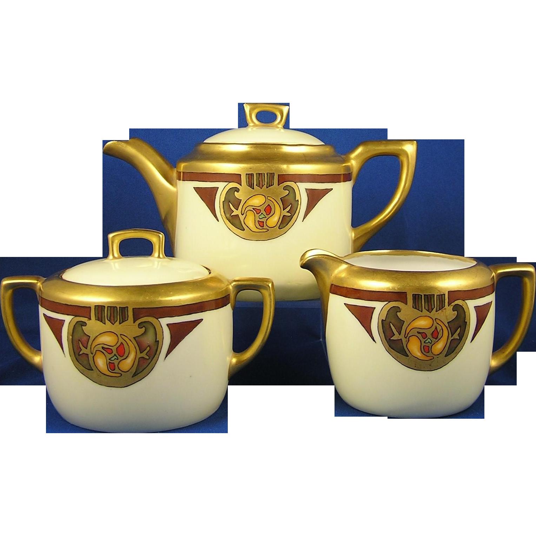 """Moritz Zdekauer (MZ) & CT Altwasser Austria Arts & Crafts Floral Design Teapot, Creamer & Sugar Set (Signed """"H. Dietz""""/c.1909-1920)"""