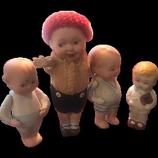 Four All Bisque Antique Dolls!