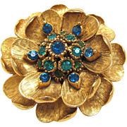 Signed Florenza Flower Brooch with Green Rhinestone Center